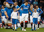 Rangers captain Lee McCulloch leads out mascots Declan and Kieran Duffy before the match at Ibrox