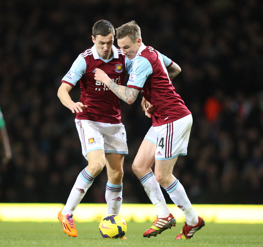 West Ham United's Stewart Downing and West Ham United's Matthew Taylor<br /> <br /> Photo by Kieran Galvin/CameraSport<br /> <br /> Football - Barclays Premiership - West Ham United v Norwich City - Tuesday 11th February 2014 - Boleyn Ground - London<br /> <br /> &copy; CameraSport - 43 Linden Ave. Countesthorpe. Leicester. England. LE8 5PG - Tel: +44 (0) 116 277 4147 - admin@camerasport.com - www.camerasport.com