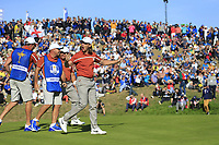 Tommy Fleetwood (Team Europe) sinks his putt on the 9th green during Saturday's Foursomes Matches at the 2018 Ryder Cup 2018, Le Golf National, Ile-de-France, France. 29/09/2018.<br /> Picture Eoin Clarke / Golffile.ie<br /> <br /> All photo usage must carry mandatory copyright credit (© Golffile | Eoin Clarke)