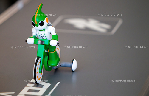 Sept. 15, 2011 - Tokyo, Japan - Panasonic's EVOLTA bike robot cycles down the runway during the company's EVOLTA World Challenge IV press conference. The next EVOLTA challenge will take place in Hawaii at the Ironman Triathlon Course, total of approximately 230km in 3 events that include swimming, biking and running. The goal is for the robot to reach the finish line within one week. (Photo by Christopher Jue/AFLO)