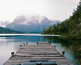 ARGENTINA, Patagonia, wooden jetty in Moreno Lake with mountain in the background