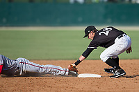 Kannapolis Intimidators shortstop Grant Massey (28) holds the tag on the foot of Telmito Agustin (8) of the Hagerstown Suns during the game at Kannapolis Intimidators Stadium on June 15, 2017 in Kannapolis, North Carolina.  The Intimidators walked-off the Suns 5-4 in game one of a double-header.  (Brian Westerholt/Four Seam Images)
