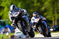 Chris Clark leads another motorcycle over hill at the AMA Superbike Showdown at Road Atlanta, Braselton, GA, April 2010.  (Photo by Brian Cleary/www.bcpix.com)