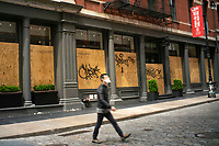 NEW YORK, NY - APRIL 20: The Store Kate Spade is seen covered with plywoods due to COVID-19 pandemic on April 20, 2020. in New York City. United States. U.S. President Trump is looking to get many Americans back to work as soon as possible, but also he recognizes that cities like New York will need to go slow. (Photo by Eduardo MunozAlvarez/VIEWpress)