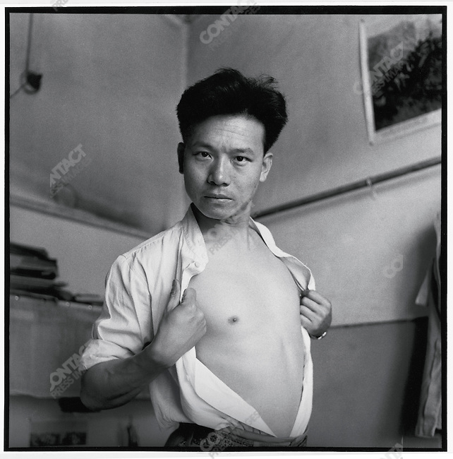 Li in his office at the Heilongjiang Daily in Harbin impersonates a mythical movie hero confronting his enemy and ready to fight (photographed with a self-timer). 15 June 1966