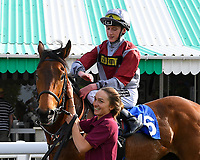 Winner of The Penang Turf Club Malaysia Handicap (Class 5)  Beyond Equal ridden by David Egan and trained by Stuart Kittow is led into the winners enclosure during Afternoon Racing at Salisbury Racecourse on 17th May 2018