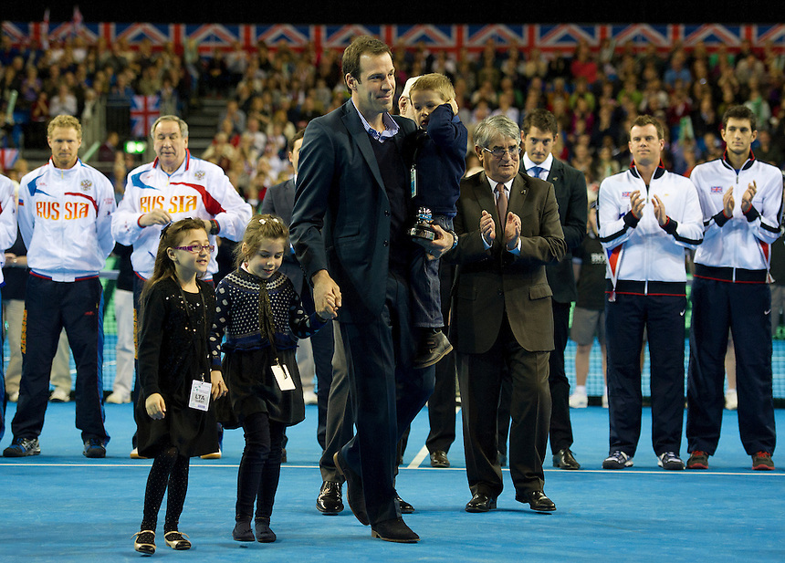 Greg Rusedski receives the Davis Cup Commitment Award before play commences.. - (Photo by Stephen White) ..International Tennis -  - Davis Cup by BNP Paribas - Europe/Africa Zone Group I Second Round - Great Britain v Russia - Day 1 - Friday 5th April 2013 - Ricoh Arena - Coventry - UK..© CameraSport - 43 Linden Ave. Countesthorpe. Leicester. England. LE8 5PG - Tel: +44 (0) 116 277 4147 - admin@camerasport.com - www.camerasport.com