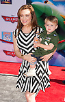 Catherine Bell and son Milo Bugliari arriving at the World Premiere of Planes held at El Capitan Theatre in Los Angeles, Ca. August 5, 2013.