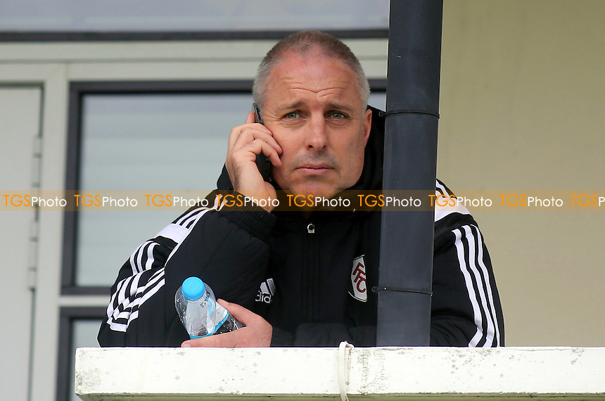 Fulham's caretaker manager, Kit Symons, takes a call on his mobile phone while watching Fulham Under 21's beat Liverpool Under 21's - Fulham Under-21 vs Liverpool Under-21 - Barclays Under-21 Premier League Football at Motspur Park Training Ground, Surrey - 26/10/14 - MANDATORY CREDIT: Paul Dennis/TGSPHOTO - Self billing applies where appropriate - contact@tgsphoto.co.uk - NO UNPAID USE