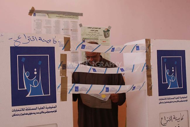 NAJAF, IRAQ: A man votes in Najaf...On March 7th, 2010, Iraq held nationwide parliamentary elections.