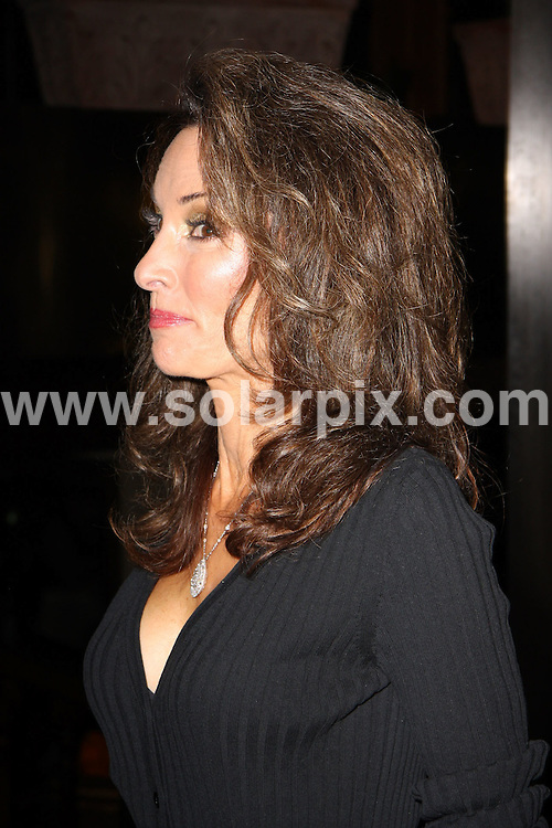 **ALL ROUND PICTURES FROM SOLARPIX.COM**.**WORLDWIDE SYNDICATION RIGHTS**.**NO PUBLICATION IN AUSTRALIA, NEW ZEALAND, DENMARK, GERMANY OR USA**.American Emmy award-winning daytime TV queen Susan Lucci and her husband have a late night dinner at madeo Restaurant. Susan wears a black ankle bandage from a recent injury. 20th October 2008..JOB REF:  7650 LAP (JS)       DATE: 20_10_2008.**MUST CREDIT SOLARPIX.COM OR DOUBLE FEE WILL BE CHARGED* *UNDER NO CIRCUMSTANCES IS THIS IMAGE TO BE REPRODUCED FOR ANY ONLINE EDITION WITHOUT PRIOR PERMISSION*