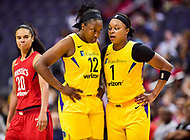 Washington, DC - June 15, 2018: Los Angeles Sparks guard Chelsea Gray (12) and Los Angeles Sparks guard Odyssey Sims (1) talk during a timeout of game between the Washington Mystics and Los Angeles Sparks at the Capital One Arena in Washington, DC. (Photo by Phil Peters/Media Images International)