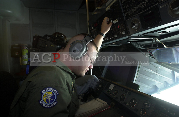 """Boom operator Staff Sgt. """"David"""" from Houston, Texas operates the boom of a KC-10 air tanker over California Friday Oct. 5 2001. His plane is from the Sixth air refueling Squadron at Travis Air Force Base in Fairfield California. The KC-10 tankers can transfer up to 340,000 pounds of fuel on a mission. (CONTRA COSTA TIMES/ ALAN GRETH)"""