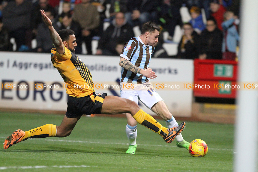 Leon Legge of Cambridge United tries to block the shot of Nathan Thomas of Mansfield Town during Cambridge United vs Mansfield Town, Sky Bet League 2 Football at the Abbey Stadium, Cambridge, England on 19/12/2015