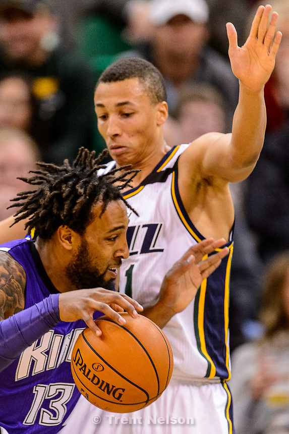 Trent Nelson  |  The Salt Lake Tribune<br /> Sacramento Kings forward Derrick Williams (13) drives on Utah Jazz guard Dante Exum (11) as the Utah Jazz host the Sacramento Kings at EnergySolutions Arena in Salt Lake City, Wednesday April 8, 2015.
