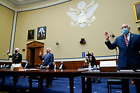 Robert Redfield, director of the Centers for Disease Control and Prevention (CDC), from right, Anthony Fauci, director of the National Institute of Allergy and Infectious Diseases, and Admiral Brett Giroir, U.S. assistant secretary for health, swear in to a House Select Subcommittee on the Coronavirus Crisis hearing in Washington, D.C., U.S., on Friday, July 31, 2020. Trump administration officials are set to defend the federal government's response to the coronavirus crisis at the hearing hosted by a House panel calling for a national plan to contain the virus. Photographer: Erin Scott/Bloomberg/Pool<br /> Credit: Erin Scott / Pool via CNP /MediaPunch