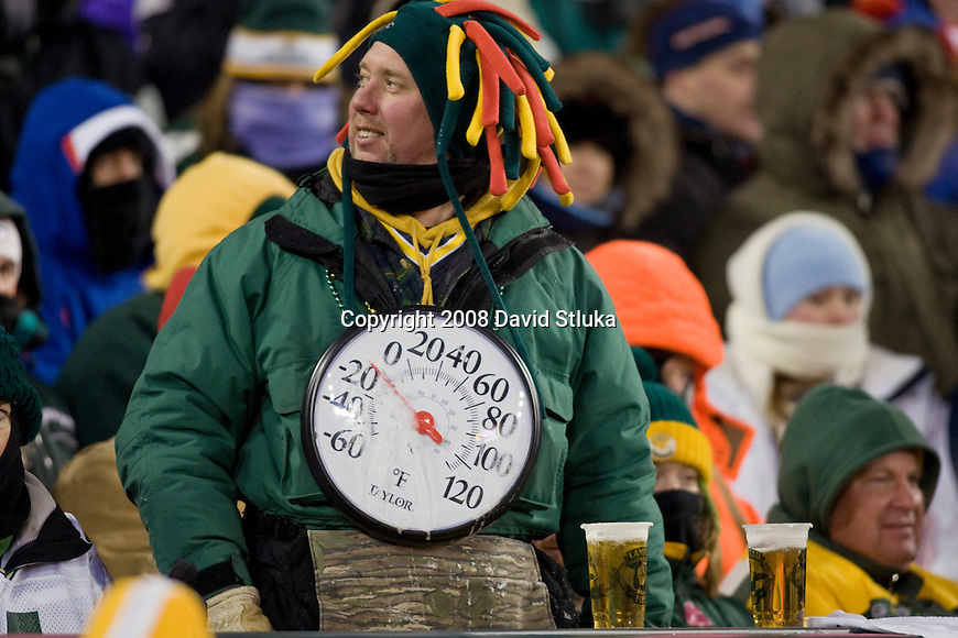 Fans of the Green Bay Packers endure freezing temperatures during the game against the New York Giants during the NFC Championship game at Lambeau Field on January 20, 2008 in Green Bay, Wisconsin. The Giants defeated the Packers 23-20 in overtime to advance to Superbowl XLII. (AP Photo/David Stluka)