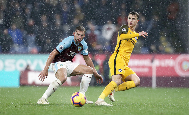 Brighton & Hove Albion's Solly March passes under pressure from Burnley's Charlie Taylor<br /> <br /> Photographer Rich Linley/CameraSport<br /> <br /> The Premier League - Burnley v Brighton and Hove Albion - Saturday 8th December 2018 - Turf Moor - Burnley<br /> <br /> World Copyright © 2018 CameraSport. All rights reserved. 43 Linden Ave. Countesthorpe. Leicester. England. LE8 5PG - Tel: +44 (0) 116 277 4147 - admin@camerasport.com - www.camerasport.com