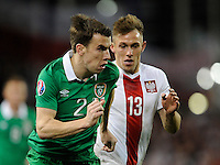 29th March 2015; UEFA EURO 2016 Championship Qualifier Group D, Ireland vs Poland, Aviva Stadium, Dublin<br /> Republic of Ireland's Seamus Coleman with Maciej Rybus of Poland<br /> Picture credit: Tommy Grealy/actionshots.ie.