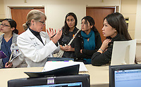 From left, Dr. Kimberly Shriner '80 talks with Cecilia Miranda '15, Pari Vanjara '14 and Amber Thai '15 at Huntington Memorial Hospital, Pasadena, Jan. 8, 2013.<br />