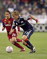 New England Revolution defender Seth Sinovic (27) controls ball on defense and starts out of the defensive zone. Real Salt Lake midfielder Ned Grabavoy (20) closes. Real Salt Lake defeated the New England Revolution, 2-1, at Gillette Stadium on October 2, 2010.