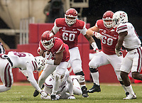 Hawgs Illustrated/BEN GOFF <br /> David Williams, Arkansas running back, braces for a hit from Johnathan Abram, Mississippi State safety, in the fourth quarter Saturday, Nov. 18, 2017, at Reynolds Razorback Stadium in Fayetteville.
