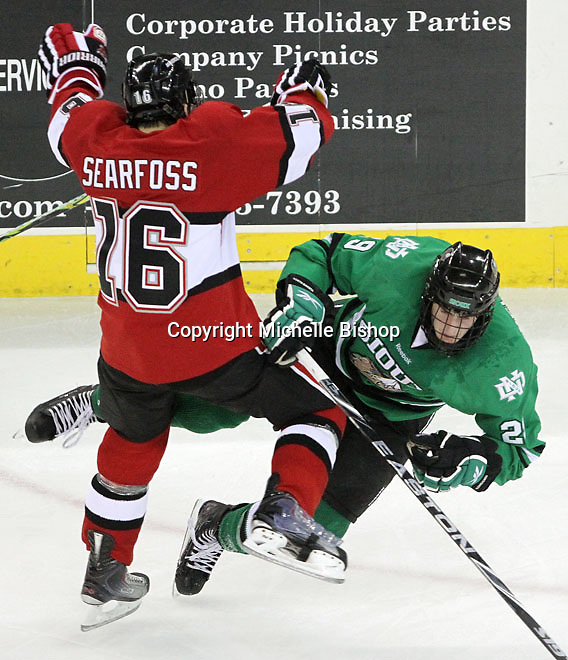 UNO's Johnnie Searfoss collides with North Dakota's Brock Nelson during the second period. Searfoss was whistled for interference on the play. No. 4 UNO beat No. 7 North Dakota 1-0 Saturday night at Qwest Center Omaha. (Photo by Michelle Bishop)