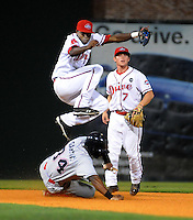 Sept. 17, 2009: Shortstop Oscar Tejeda gets out of the way of a sliding Harold Garcia to complete the first half of a double play in Game 3 of the South Atlantic League Championship Series between the Greenville Drive and the Lakewood BlueClaws Sept. 17, 2009, at Fluor Field at the West End in Greenville, S.C.  Photo by: Tom Priddy/Four Seam Images