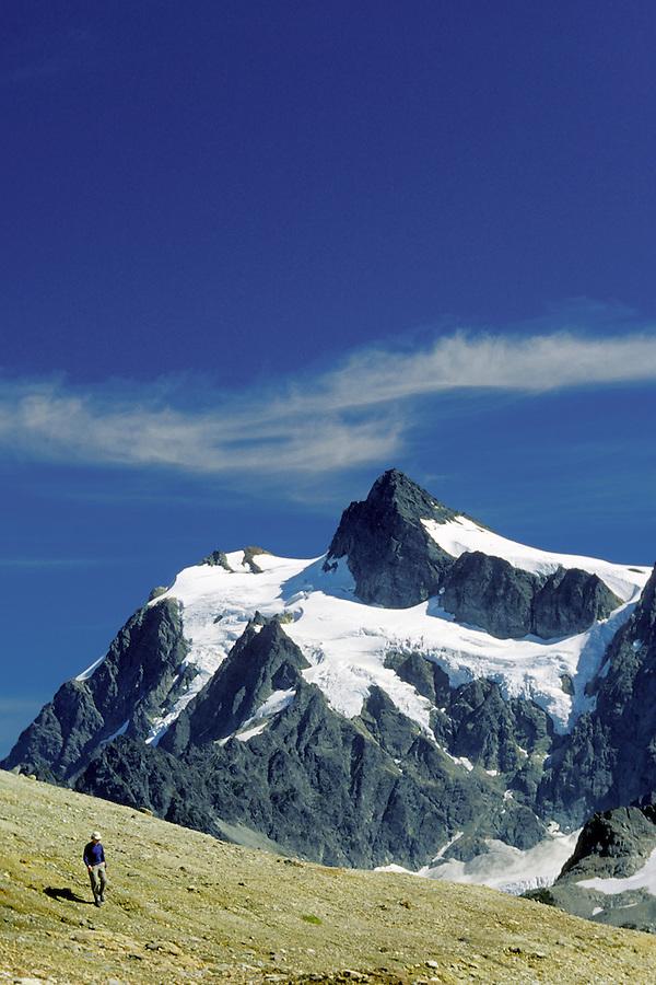 Woman hiking below Mt Shuksan, North Cascades, Cascade Mountains, Washington