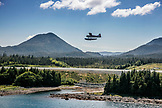 USA, Alaska, Ketchikan, a seaplane hovers above land near Ketchikan