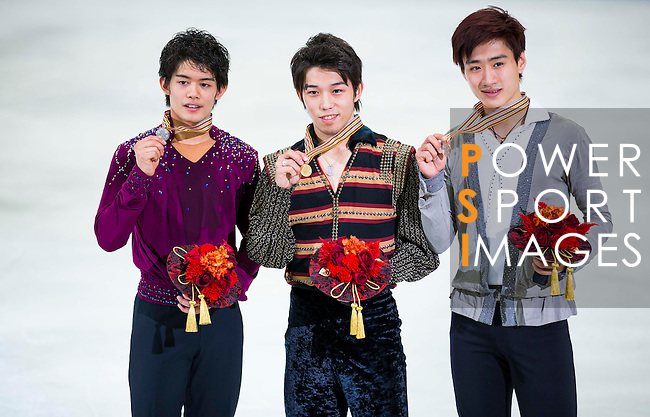 TAIPEI, TAIWAN - JANUARY 24:  Takahito Mura (C), Takahiko Kozura (L) of Japan and Nan Song of China pose with their medals after the Men Free Skating event during the Four Continents Figure Skating Championships on January 24, 2014 in Taipei, Taiwan.  Photo by Victor Fraile / Power Sport Images *** Local Caption *** Takahito Mura; Takahiko Kozura; Nan Song