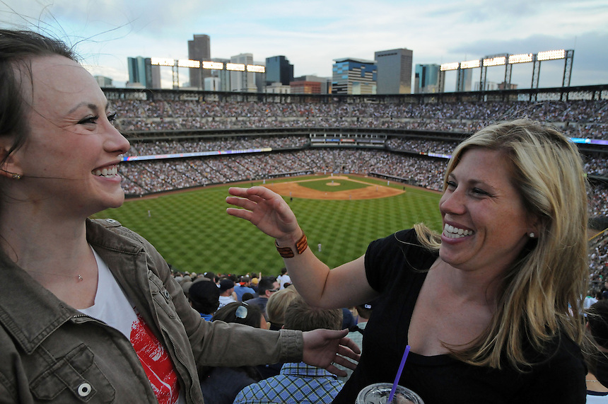 18 JUNE 2011:  A pair of female Colorado Rockies fans smile in the Rockpile during a regular season interleage game between the Detroit Tigers and the Colorado Rockies at Coors Field in Denver, Colorado. The Rockies beat the Tigers 5-4.   *****For Editorial Use Only*****