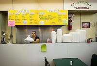 Xiomara Campos (cq) finishes a to-go plate of Carne Asada tacos with fired onions, cilantro, and limes at Cilantros Taqueria in Dallas, Texas, Thursday, September 17, 2009. ..