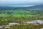 County Clare, Ireland:<br /> Limestone outcrops among the rolling hills and farms of The Burren