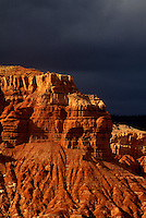 731350012 dark storm clouds form up over the red sandstone formations of the waterpocket fold in capitol reef national park in utah