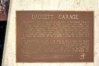 The Daggett Garage began life in the 1880s at the borax town of Marion, located on the northeast shore of Calico Dry Lake, as a locomotive repair roundhouse for the narrow-gauge Borate and Daggett Railroad. Daggett blacksmith Seymour Alf used a twenty-mule team to move the building to the Waterloo Mill and mine, southwest of Calico, circa 1896, where it served a similar purpose for a silver ore narrow-gauge railroad. Walter Alf, Seymour Alf's son, moved the building to its current location in Daggett circa 1912.<br /> <br /> The building was an auto repair shop on the National Old Trails Highway until World War II, when it became a mess hall for United States Army troops guarding the local railroad bridges. The Fouts brothers bought the building in 1946 and operated an automotive garage and machine shop in the building until the mid-1980s. The building is currently owned and operated by the Golden Mining and Trucking Company.