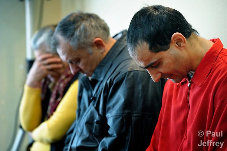 People pray during a worship service of the United Methodist Roma congregation in Jabuka, Serbia..