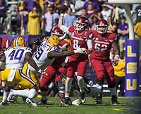 NWA Democrat-Gazette/BEN GOFF @NWABENGOFF<br /> Austin Allen, Arkansas quarterback, throws the ball as he takes a hit from Greg Gilmore (99), LSU defender, in the first quarter Saturday, Nov. 11, 2017 at Tiger Stadium in Baton Rouge, La.