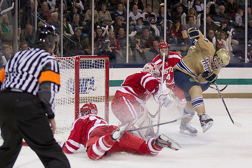 Notre Dame left wing Jeff Costello (#11) scores goal past Boston University goaltender Kieran Millan (#31) in second period action of NCAA hockey game between Notre Dame and Boston University.  The Notre Dame Fighting Irish defeated the Boston University Terriers 5-2 in game at the Compton Family Ice Arena in South Bend, Indiana.