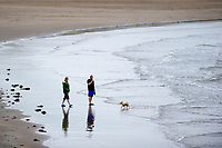 Pictured: Dog walkers at Porthcawl in Bridgend, Wales, UK. Monday 17 September 2018<br /> Re: Storm Helene is set to hit parts of Wales according to the Met Office.<br /> There is a yellow warning from 9pm and is expected to last until 6pm on Tuesday.<br /> Winds are likely to reach 40mph to 50mph with top gusts of up to 60mph.