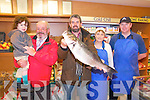 Sea Bass Catch :Pictured at Griffin's Butchers, Listowel  Derry Buckley, Duagh holding a sea bass weighing 11.44 lbs that he caught off Beale Point , Ballybunion last week. L-R : Donaghgh Buckley, Ger McElligott, Derry Buckley, Noranne Lyons & John Houlihan.