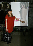 AbilityFilms@yahoo.com  805-427-3519.www.AbilityFilms.com.12-20-07 Eva Mendes posing with her new PETA campaign on Robertson blvd in Beverly hills Oops it looks like she is wearing a pair of Leather boots