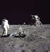 "The Moon - (FILE) -  Astronaut Edwin E.""Buzz"" Aldrin Jr., Lunar Module pilot, is photographed during the Apollo 11 extravehicular activity on the Moon on Sunday, July 20, 1969. He has just deployed the Early Apollo Scientific Experiments Package (EASEP). In the foreground is the Passive Seismic Experiment Package (PSEP); beyond it is the Laser Ranging Retro-Reflector (LR-3); in the center background is the United States flag; in the left background is the black and white lunar surface television camera; in the far right background is the Lunar Module ""Eagle"". Astronaut Neil A. Armstrong, commander, took this photograph with a 70mm lunar surface camera..Credit: NASA via CNP"