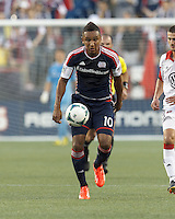 New England Revolution midfielder Juan Agudelo (10) on the attack.  In a Major League Soccer (MLS) match, the New England Revolution (blue) tied D.C. United (white), 0-0, at Gillette Stadium on June 8, 2013.