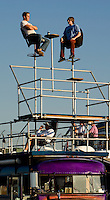 Fans sit on top of a converted bus during the Bank of America 500 NASCAR race at Lowes's Motor Speedway in Concord, NC.