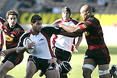 Niva Ta'auso has the attention of Mose Tuiali'i during the Ranfurly Shield challenge against Canterbury at Jade Stadium on the 10th of September 2006. Canterbury won 32 - 16.