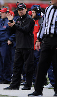 NWA Media/ J.T. Wampler -Ole Miss coach Hugh Freeze applauds a call during the first quarter against Arkansas Saturday Nov. 22, 2014.
