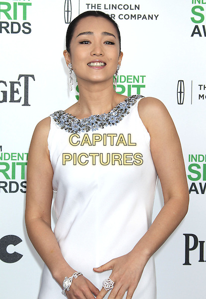 1 March 2014 - Santa Monica, California - Gong Li . 2014 Film Independent Spirit Awards held at Santa Monica Beach. <br /> CAP/ADM/RE<br /> &copy;Russ Elliot/AdMedia/Capital Pictures