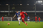 Divock Origi of Liverpool and Seamus Coleman of Everton during the English Premier League match at Goodison Park, Liverpool. Picture date: December 19th, 2016. Photo credit should read: Lynne Cameron/Sportimage