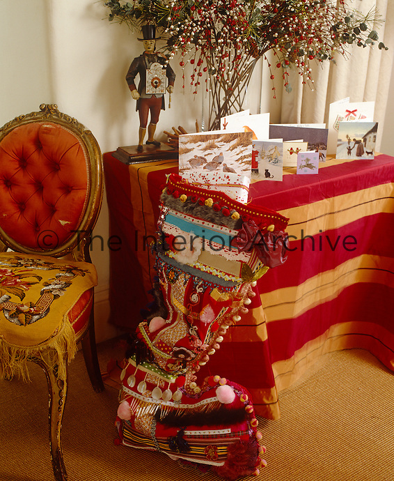 A large Christmas stocking leans against a side table in the living room
